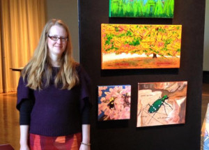 Artist Janal Houton with some of her Massachusetts Endangered Species Art