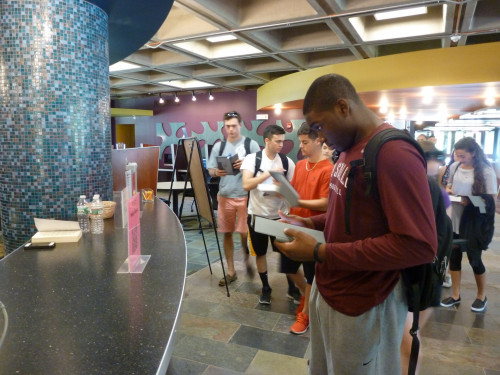 First Year Students using their iPads to learn about the library.