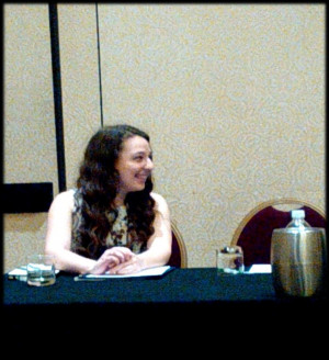 <em><strong>Cat chats with fellow panelists at the Nature Poetry panel</strong></em>