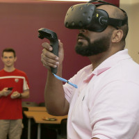 Faculty member using VR technology. Apple Initiative. Merrimack College. Photo by Mary Schwalm 5/...