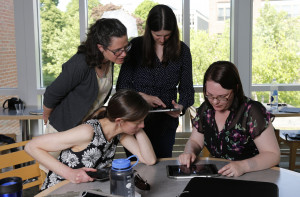 Faculty and students working together using an iPad.Apple Initiative. Merrimack College. Photo by...