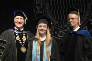 Shown here with Laura are President Christopher Hopey and Michael Rossi, Dean of Liberal Arts