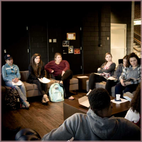 Students listening to Rabbi Mandell's stories, at Lounge 47