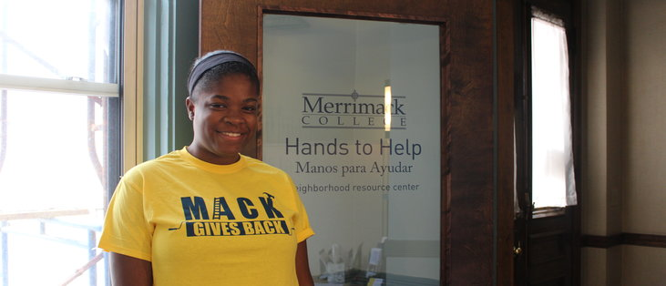 Deidra Collins proudly displaying her Mack Gives Back T-shirt.