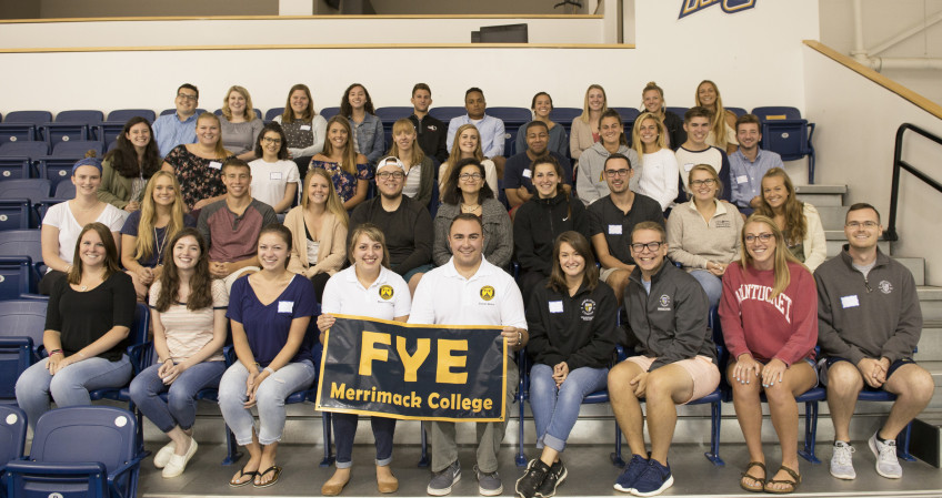 FYE mentors group photo on arena bleachers