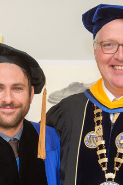 Merrimack College alumni Charlie Day 98' with President Christopher E. Hopey, Ph.D.