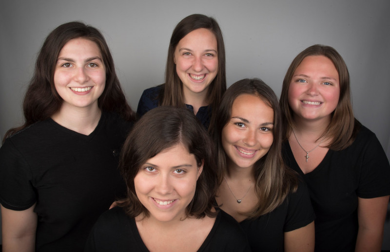 This is a portrait photo of the DREAM Student Leaders and the DREAM Staff Advisor. There is a gre...