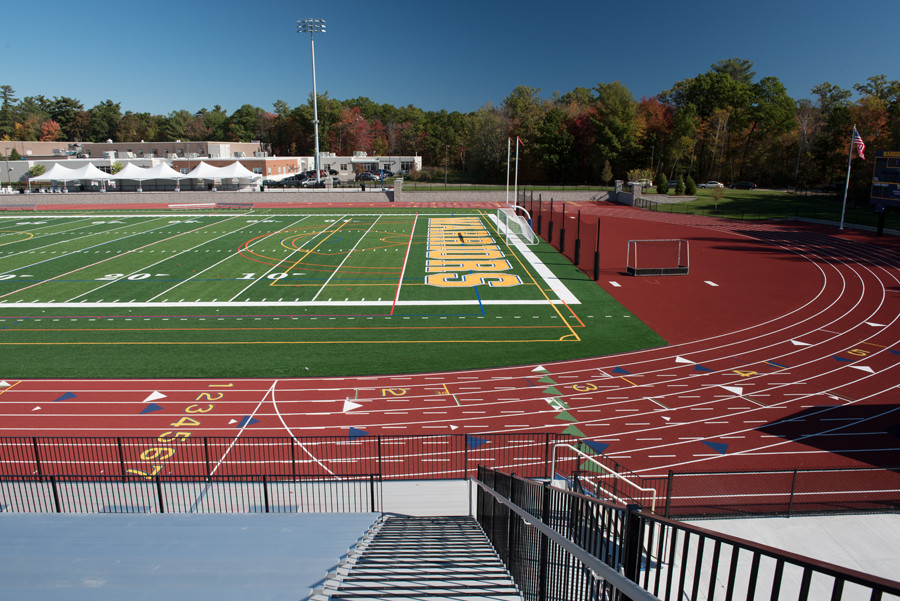 A view of the athletic field and track as seen from the bleachers.