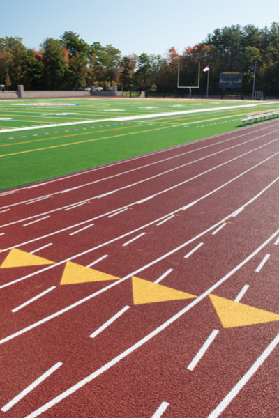 An eight-lane track surrounds the newly turfed field.