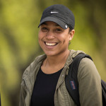 Merrimack College Student smiling during the fall season.