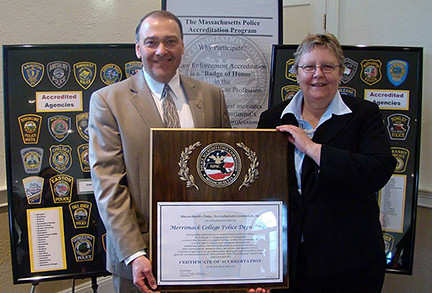 Merrimack police Chief Michael DelGreco and Lt. Jan Fuller celebrate the department's professio...