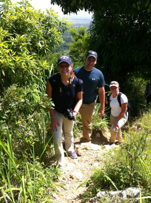 Students Chelsea Jacoby, Dan Borges, and Mollie Fitzgerald climb a mountain to look at water from natural springs that Merrimack is looking to help safely distribute. People from Haiti still die and are sick all too often from cholera and other diseases stemming from unsafe water.