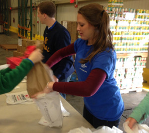 Merrimack students Anthony Fonte '16 and Hannah Lee '17 volunteer to distribute food and supplies in Washington, D.C. on t...