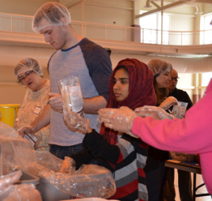 Volunteers from Merrimack and interfaith communities throughout the Merrimack Valley packaged over 12,000 meals for donation to the Merrimack Valley Food Bank.