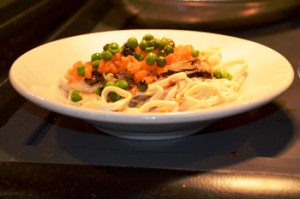 Traditionally, Lunar New Year is celebrated with many foods that hold symbolism for luck and prosperity. Sparky's offered many dishes including this one of long, unbroken noodles representing longevity.
