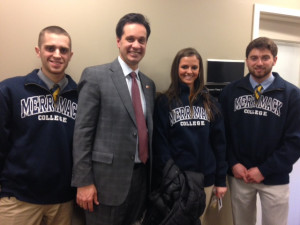 "Merrimack students (left to right) Cole Ruley, '17, Briana Tierney, '16, and Joseph Arena, 17, met with state Sen. Viriato ""Vinny"" DeMacedo, D-Plymouth (second from left) during Financial Aid Day at the Statehouse Feb. 25. Students visited the offices of state representatives and senators representing their hometowns and Merrimack thanking them for their support for financial aid."