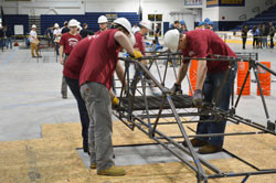 Students from Merrimack's Civil Engineering department placed third in the New England regional 2015 Student Conference & Steel Bridge Competition April 10-11.