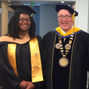 Graduate student speaker Keiara Perry and President Christopher Hopey