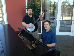 Kevin Wilson, of Religious & Theological Studies Department (left) will kick off the Atrium Concert Series playing banjo in the Rogers Center Oct . 7 at noon. Director of Campus Music Activities Hugh Hinton (right) will take his turn in the musical line-up Oct. 28.