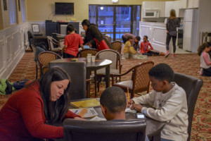 Kristy Forrest, a community engagement graduate fellow, tutoring elementary school students at Royal Crest Estates North A...