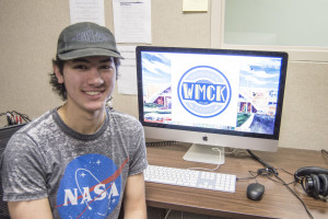 Michael Giammasi '18, co-president of WMCK, designed the winning logo for Merrimack College's new radio station.
