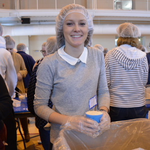 Early Childhood Education major Olivia Nasson '17, of Lynnfield, Mass., volunteered to pack meals in this year's annual interfaith meal-packing program.