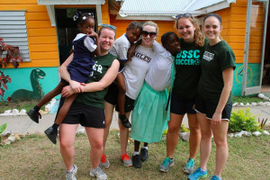Students who participated in the International Service Immersion experience to Kingston, Jamaica spent time with residents at Mustard Seed, an organization that takes in disabled children and adults.