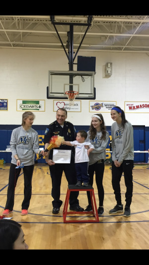 Police Chief Mike DelGreco presented awards to the participants at the Young Athletes Program by Special Olympics. Merrimack volunteers are (from left) Morgan Sleeman, Caitlin Saad, and Ashley Quinn.