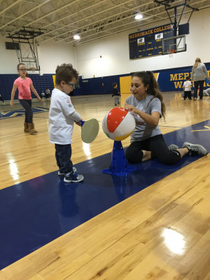 Merrimack student  Adriana Raneri plays with a child during a Young Athletes Program by Special Olympics session.