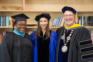 Merrimack College President Christopher E. Hopey, Ph.D. (right) with graduate school commencement speaker Barbara Pierce B...