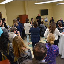 Father John Dell Russo, OSA, speaks at Hands to Help open house earlier this month.