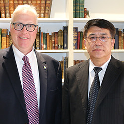 President Hopey poses with his counterpart from Heilongjiang Institute of Technology, President Zhang Hongtian.