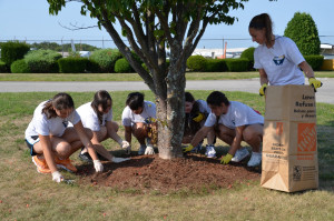 Students help landscape at the Lawrence Airport.
