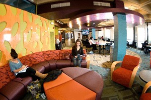 Students lounge on comfy seats in the newly redesigned library.