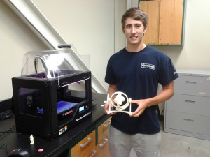 Merrimack College engineering student Michael Stehnach made a gyroscopic complex gear system using a 3-D printer in Civil and Mechanical Engineering Department recently.