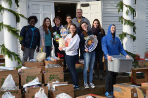 The Merrimack College community is donating over 90 full Thanksgiving turkey dinners to Neighbors in Need in Lawrence. After having packed up three vans full of boxes, the Campus Ministry staff and volunteers try to organize more boxes of dinners for the next available van. The community wishes all a very happy Thanksgiving day!