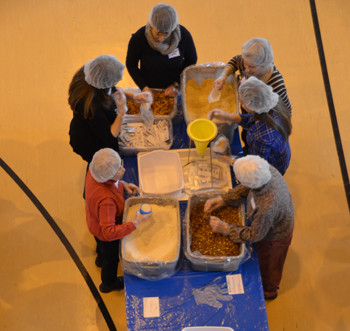 Volunteers from Merrimack and interfaith communities throughout the Merrimack Valley packaged ove...