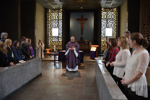 The Pellegrinaggio group attends Mass at Our Mother of Good Counsel Chapel in Austin Hall. During...