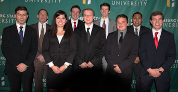 Merrimack's Moot Court team and its advisor adjunct professor Robert Chwaliszewski.