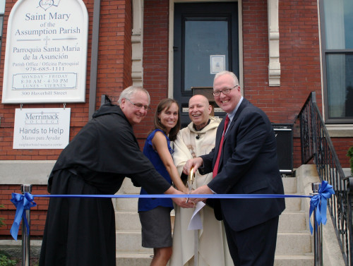From left, Father Ray Dlugos, Merrimack; Alysha Reppucci, Hands to Help director; Father Carl...