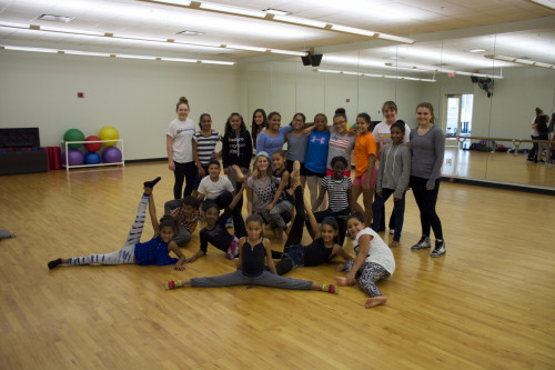 The Merrimack Dancers take a rest with the dancers from the Lawrence Boys-Girls Club during a rec...