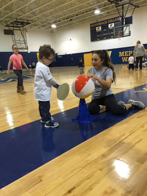 Merrimack student  Adriana Raneri plays with a child during a Young Athletes Program by Special O...