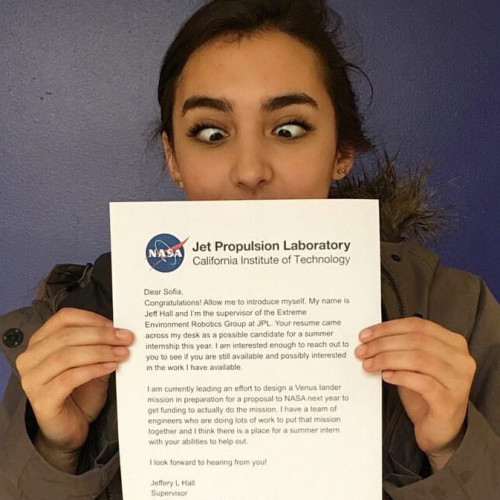 Mechanical engineer student Sofia Basauri holds up her acceptance letter to NASA's Jet Propulsion...