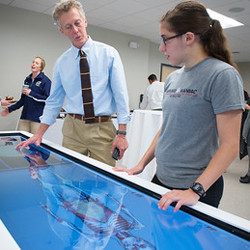 Adjunct lecturer Andrew Cannon demonstrates the Antotamage 3-D medical imaging table.