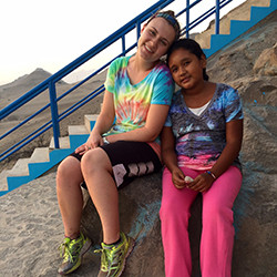 Andria Auger poses with a local girl on a past trip to Peru.