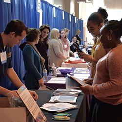 Lorie Dorcé '20, right, and Brianna Raphino '20 check out materials at the career fair.