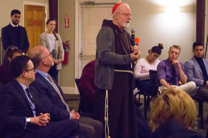 Cardinal Seán O'Malley speaks with Austin Scholars during a visit to Merrimack on March 14, 2018.