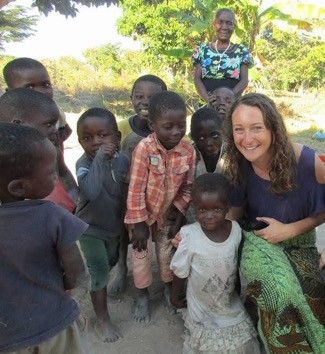 Fiona Coleman '14, helping children from a small village in Zambia.