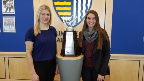 Right wing Jessica Bonfe, and center Madison Morey designed the new trophy for Hockey East Associ...