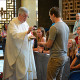 Father Edward Enright, OSA, hands out communion at Monday's Mass.